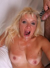 Explicit live cam show with Renee sucking off and riding a younger guys cock in bed